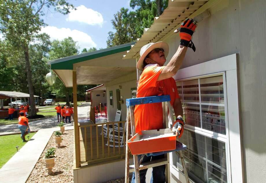 Phil Schiffman works on painting a cottage at Hope Cancer Retreat, Thursday, July 27, 2017, in Splendora. Ten Home Depot stores gathered at the non-profit to work on various projects from landscaping to painting. The organization offers housing to those seeking cancer treatment in Houston for $25 a night for up to three months. Photo: Jason Fochtman, Staff Photographer / © 2017 Houston Chronicle