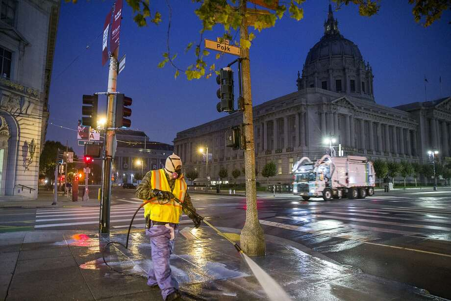 Bernard Sices of San Francisco's Public Works Department cleans the sidewalk near City Hall. The neigh borhood, which attracts thousands of people each day, draws complaints of dirty sidewalks and drug use. Photo: Santiago Mejia, The Chronicle