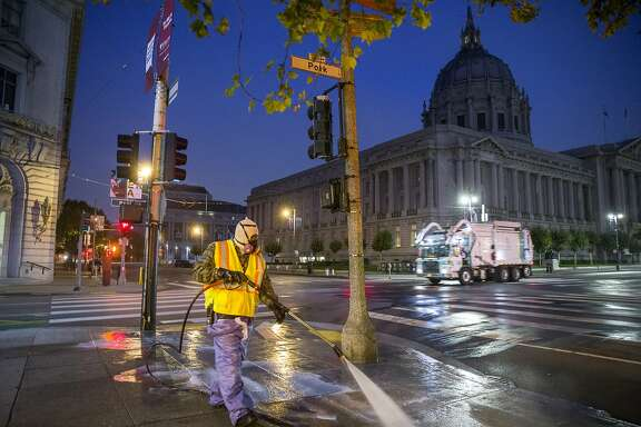 Bernard Sices with S.F. Public Works washes down the sidewalk near City Hall at 5:30 a.m. on Thursday, July 27, 2017, in San Francisco, Calif.