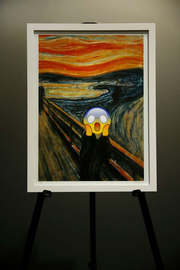 "An emoji appears over a copy of Edvard Munch's ""The Scream"" at Emojicon. Photo: Santiago Mejia, The Chronicle"