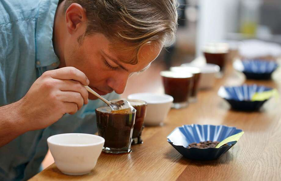 Owner Kevin Bohlin inhales the aroma of a coffee sample at the newest Saint Frank Coffee on Mission Street. Photo: Leah Millis, The Chronicle