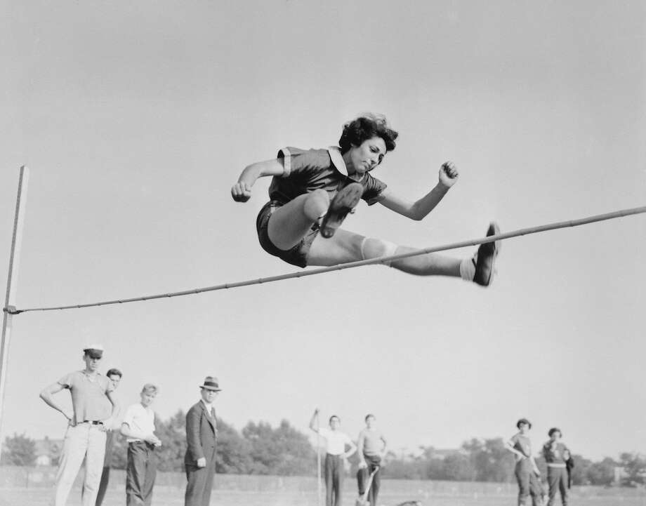 Margaret Bergmann soars over the high jump bar to win the event at the U.S. track and field championships in 1937, the year she immigrated to the U.S. Photo: Bettmann�/ Contributor, Getty Images