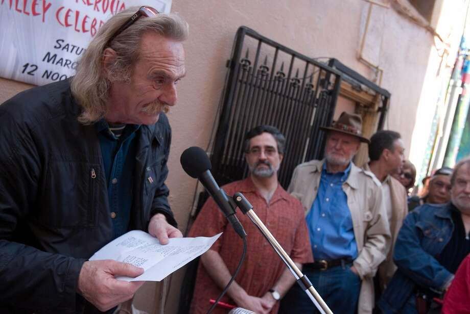 Jack Hirschman, then S.F.'s poet laureate, reads to a crowd including Supervisor Aaron Peskin (center) and poet Lawrence Ferlinghetti at the dedication of North Beach's Jack Kerouac Alley in March 2007. Photo: Darryl Bush, SFC