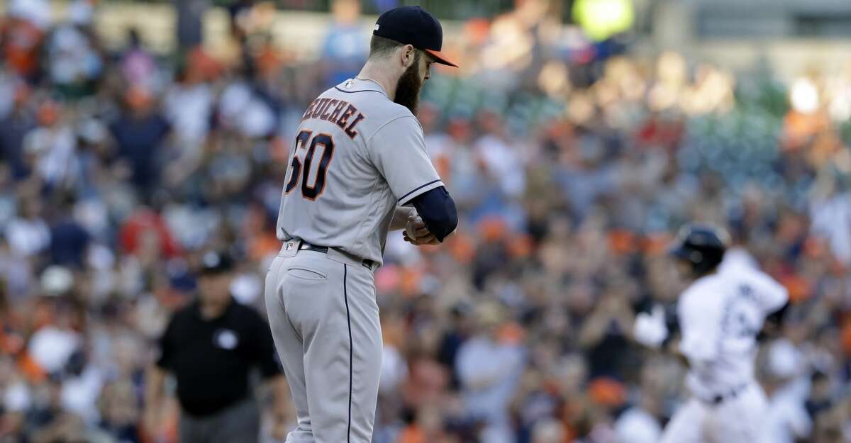 Houston Astros starting pitcher Dallas Keuchel walks on the mound after giving up a three-run home run to Detroit Tigers' Nicholas Castellanos during the second inning of a baseball game, Friday, July 28, 2017, in Detroit. (AP Photo/Carlos Osorio)