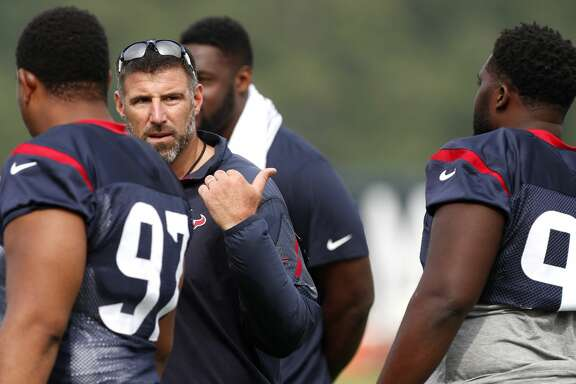 Houston Texans defensive coordinator Mike Vrabel, center, works with nose tackle Rickey Hatley (97) and defensive tackle Brandon Dunn (92) during training camp at the Greenbrier on Thursday, July 27, 2017, in White Sulphur Springs, W.Va. ( Brett Coomer / Houston Chronicle )