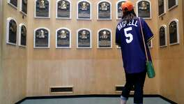 Becky Morris, of Houston, wears her Bagwell jersey as she walks through the Baseball Hall of Fame Museum, Friday, July 28, 2017, in Cooperstown, ahead of Jeff Bagwell's induction into the Hall of Fame, Sunday. ( Karen Warren / Houston Chronicle )