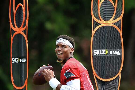 Carolina quarterback Cam Newton is focused on his task as he goes through a footwork drill during the Panthers' practice at Spartanburg, S.C.