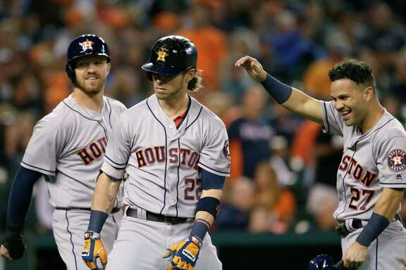 Josh Reddick, center, celebrates with Derek Fisher, left, and Jose Altuve after Reddick's three-run homer against the Tigers during the eighth inning at Detroit's Comerica Park on Friday night. Reddick drove in five runs as the Astros won 6-5.