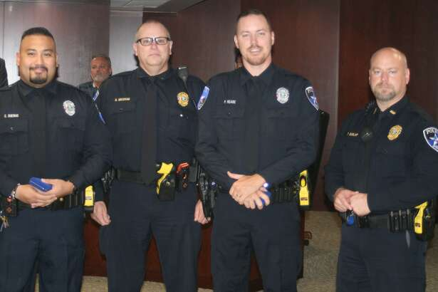 From left are Medal of Bravery recipient Officer Duenas, Asst. Chief Gresham, Medal of Bravery recipient Officer Reade and Lt. Troye Dunlap.