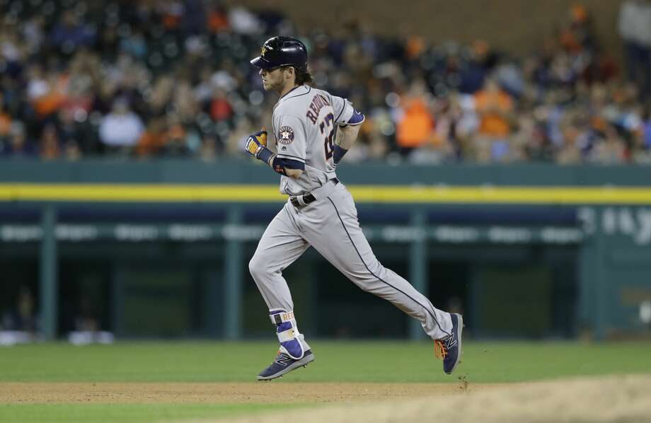 Houston Astros' Josh Reddick rounds the bases after his three-run home run off Detroit Tigers relief pitcher Bruce Rondon during the eighth inning of a baseball game, Friday, July 28, 2017, in Detroit. (AP Photo/Carlos Osorio) Photo: Carlos Osorio/Associated Press