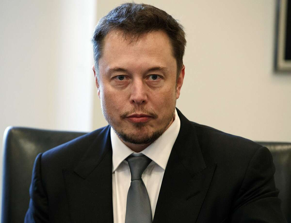 FILE - In this Dec. 14, 2016, file photo, Tesla CEO Elon Musk listens as President-elect Donald Trump speaks during a meeting with technology industry leaders at Trump Tower in New York. In a Tweet, Musk says he has