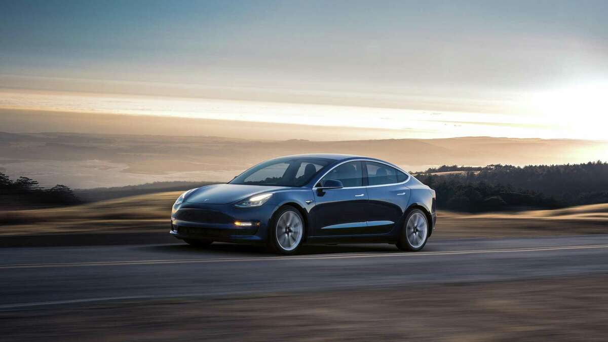 The blue Tesla Model 3. Model 3 is currently in production, and deliveries to employee reservation holders began on July 28, 2017 at the Tesla Factory in Fremont.