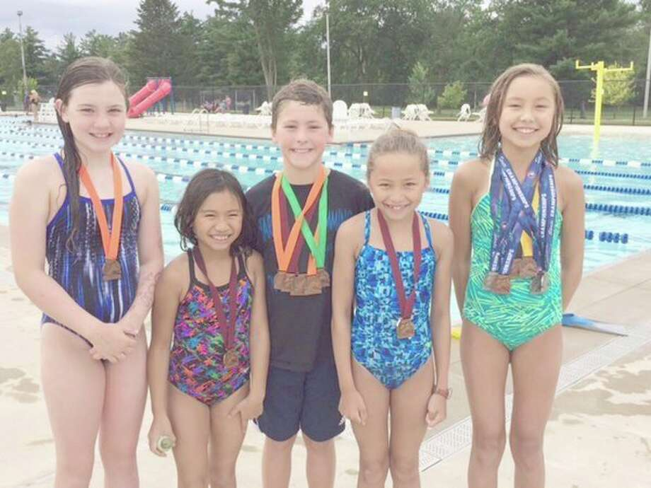 From left, Emmy Sower, Amy Casipit, Eli Soderberg, Vera Roberson and Ella Roberson of the Midland Dolphins/Barracudas competed at the 12U Summer State Meet at Eastern Michigan University last weekend.