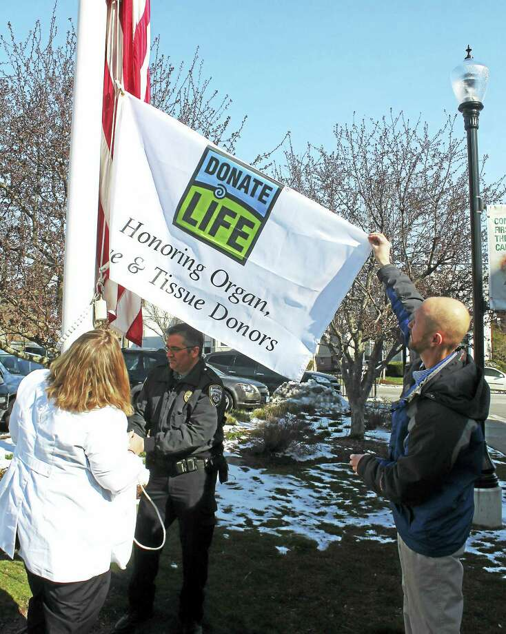 Middlesex Hospital holds a ceremonial flag raising with LifeChoice Donor services in honor of Donate Life Month, April 2016. The ceremony honored and celebrated the lives of those who had given the gift of life, their families; and the staff at the hospital for ongoing support of the program. Photo: Photo By Emily Olson