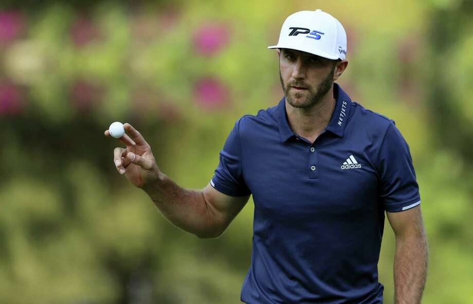 Dustin Johnson shows the ball after hitting at the 17th green during the final round of the Mexico Championship on Sunday. Photo: Christian Palma — The Associated Press   / Copyright 2017 The Associated Press. All rights reserved.