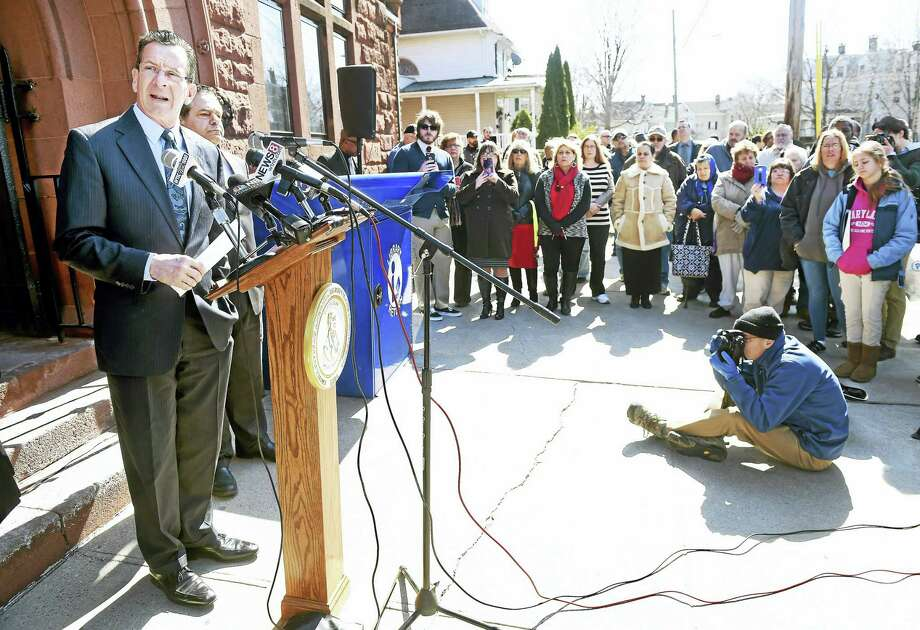 Gov. Dannel Malloy, left, speaks about school funding during a press conference in front of the Ansonia Public Library Monday. Photo: Arnold Gold —New Haven Register