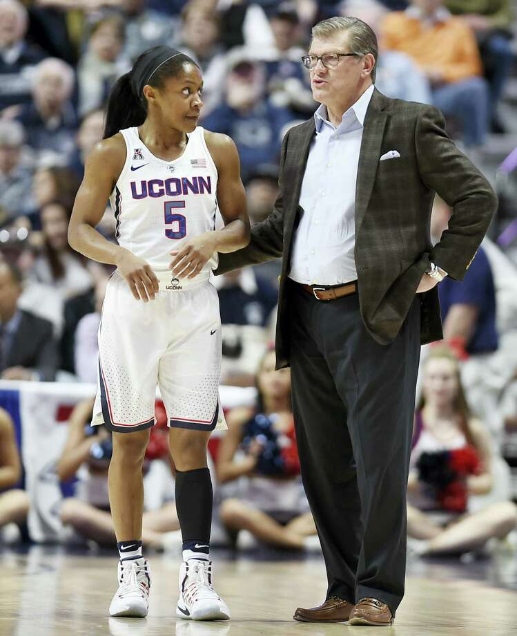 UConn head coach Geno Auriemma, right, talks with Crystal Dangerfield during Sunday's AAC semifinal. Photo: Jessica Hill — The Associated Press   / AP2017