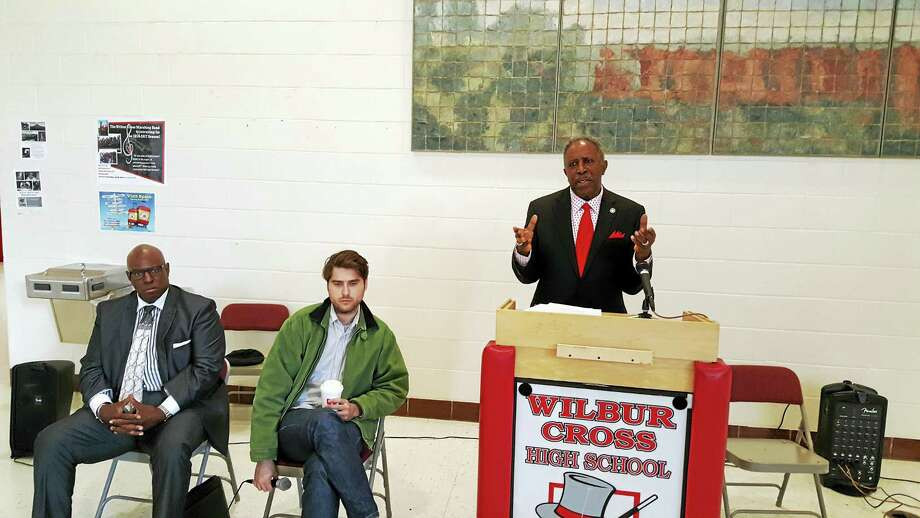 Connecticut Supreme Court Justice Lubbie Harper Jr. introduces Benjamin Lear during a panel discussion at Wilbur Cross High School. Photo: Jahi Brooks Photo