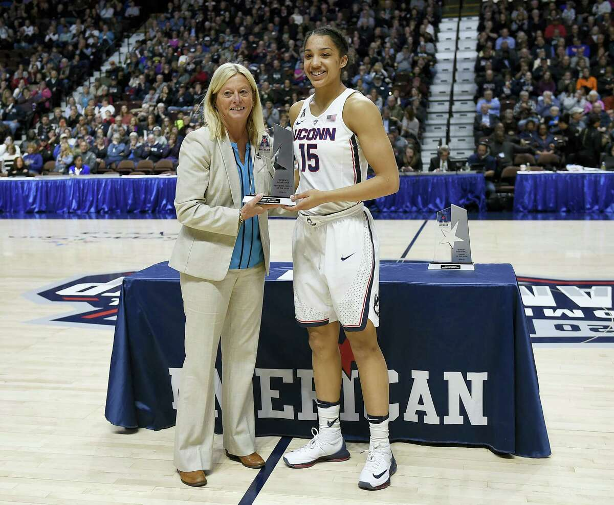 UConn's Gabby Williams, right, receives the conference defense player of the year award from Barbara Jacobs, Associate Commissioner of Women's Basketball, before Saturday's game.