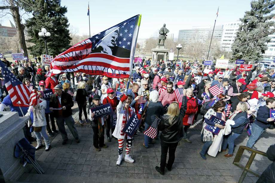 Supporters of President Donald Trump gather during a March 4 Trump rally on the state Capitol steps in Denver, Saturday, March 4, 2017. Photo: AP Photo/Brennan Linsley    / Copyright 2017 The Associated Press. All rights reserved.