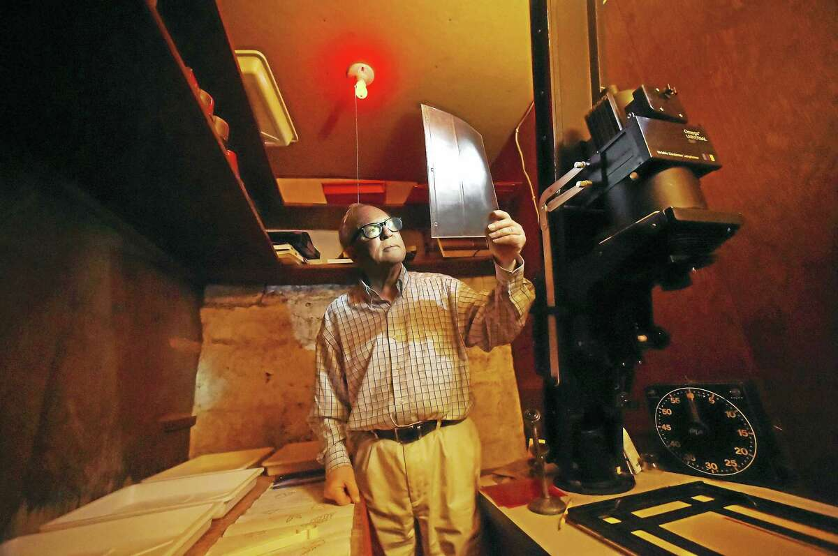 Raymond Smith of New Haven, a noted American photographer who also operates R.W. Smith Bookseller, in a darkroom at his home. Wednesday, March 1, 2017.
