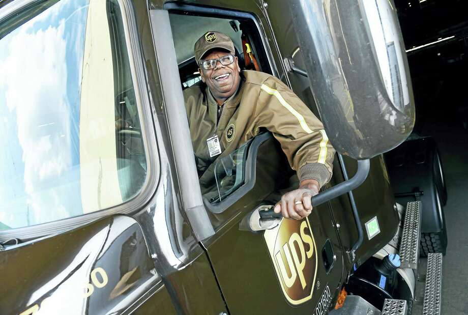 United Parcel Service truck driver Walter Beasley, photographed in a Mack Pinnacle tractor trailer at the UPS hub facility in Stratford, has achieved a new milestone within the company's Circle of Honor for his 45 years of safe driving. Photo: Arnold Gold-New Haven Register