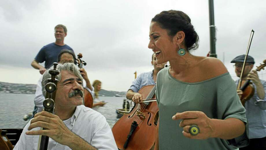 Kayhan Kalhor, left, and Aynur Dog perform with other members of Silk Road Ensemble. Photo: Photo Courtesy Of HBO