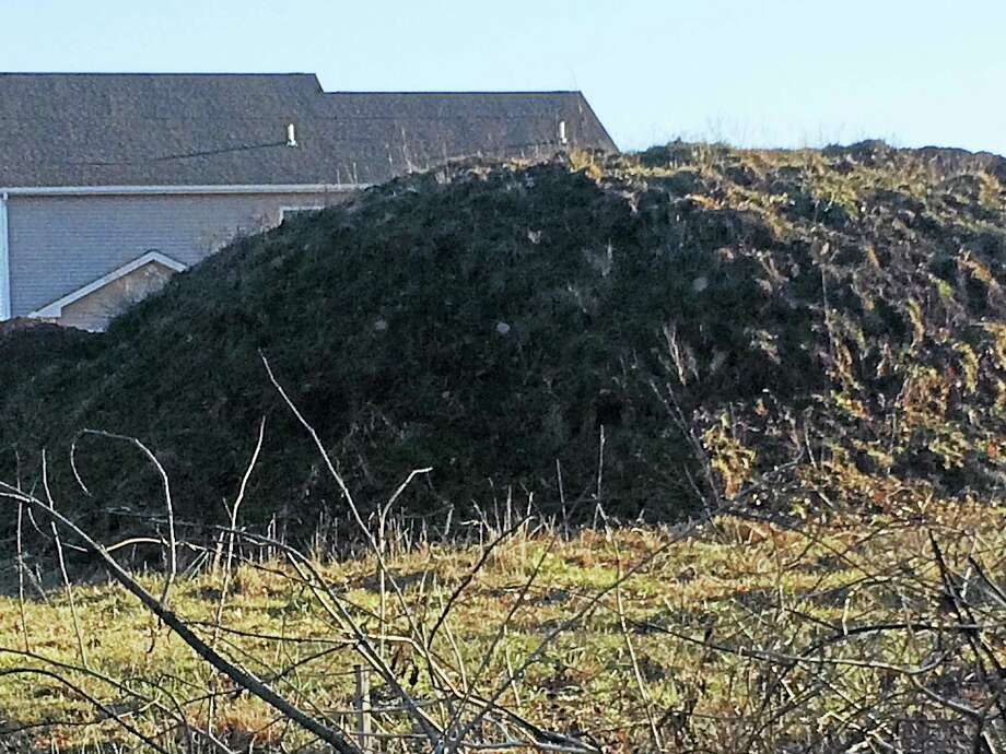 LUTHER TURMELLE — NEW HAVEN REGISTER  One of the large mounds of dirt that Sunwood Development has left adjacent to Steven Yost's New Cheshire Road Property in Wallingford. Dust storms caused by the dirt mounds allegedly have caused $6,000 worth of damage to Yost's home and pool, he said. Photo: Digital First Media