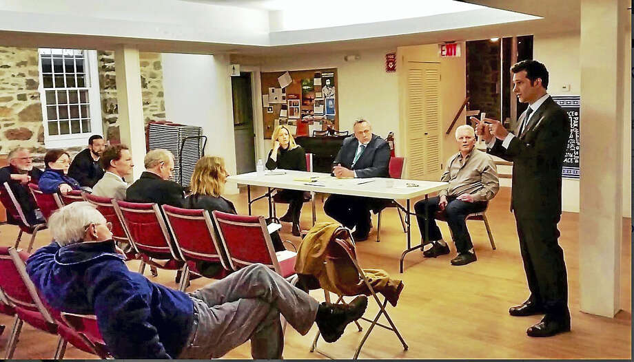 State Rep. Michael D'Agostino, D-Hamden, speaks to residents living in the area of Whitneyville Thursday night at a forum with Mayor Curt Balzano Leng addressing the increases in their property assessments during the last revaluation. Photo: Kate Ramunni — New Haven Register