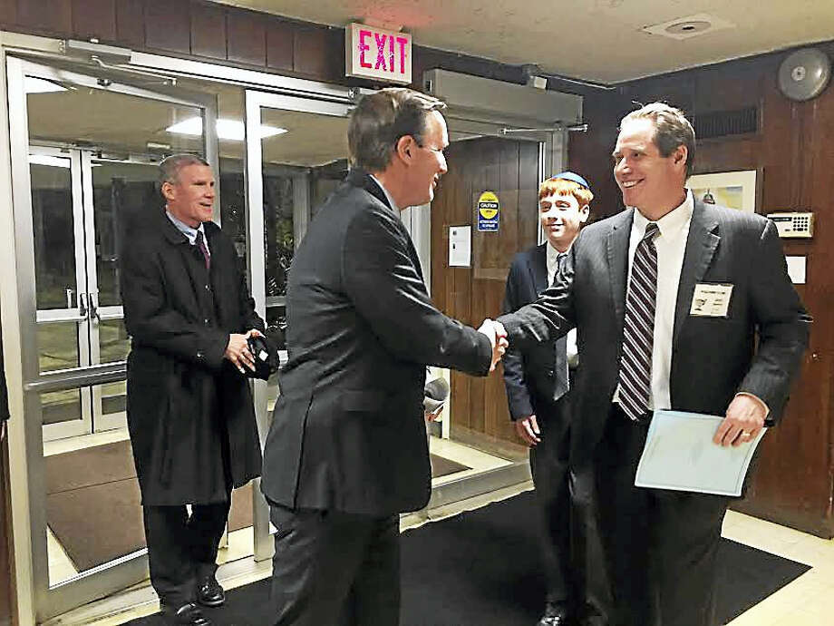 U.S. Sen. Chris Murphy is greeted at Congregation Mishkan Israel Friday by his friend, Mishkan Israel board member Joel Rudikoff. Photo: Brian Zahn — New Haven Register