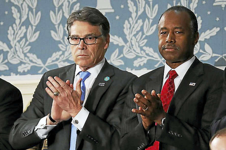 Rick Perry, left, and Housing and Urban Development Secretary-designate Ben Carson applaud on Capitol Hill in Washington, Tuesday, Feb. 28, 2017, before President Donald Trump's address to a joint session of Congress. Photo: AP Photo/Pablo Martinez Monsivais