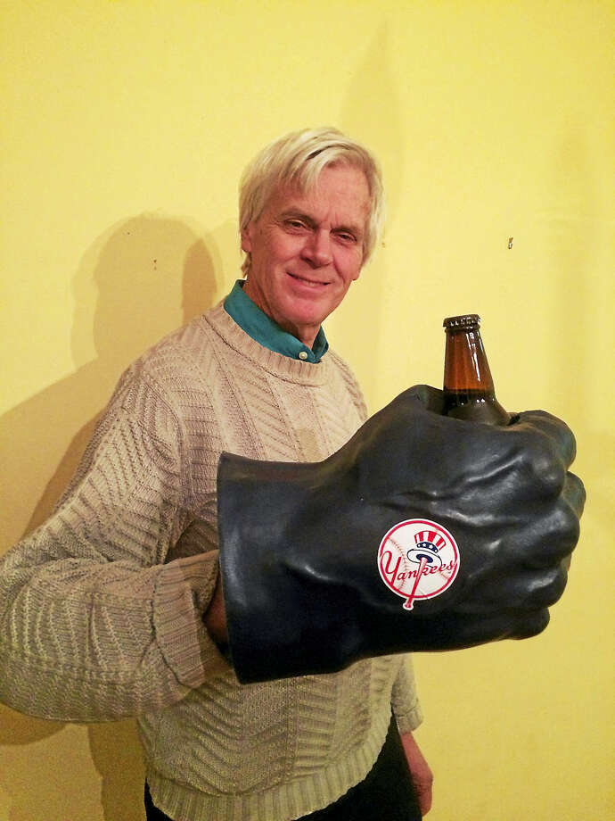 Columnist Randall Beach displays a funky but unnecessary souvenir he donated to Goodwill as part of his daily New Year's resolution. Photo: Contributed Photo - Jennifer Kaylin