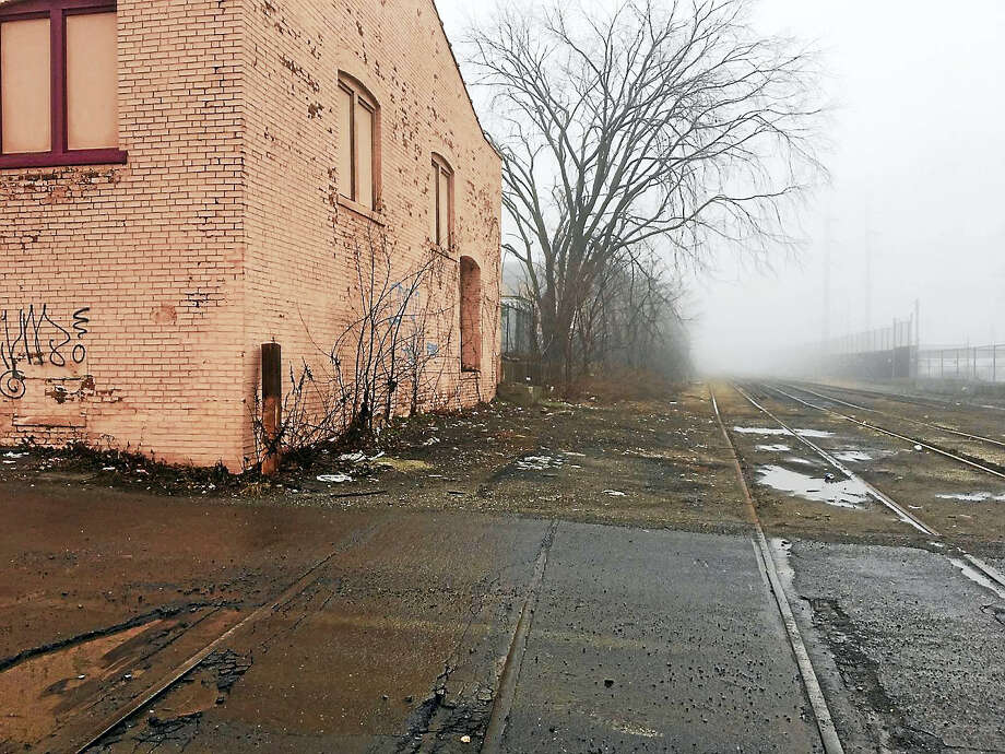 Freight tracks owned by Genesee and Wyoming rail line run close to the rear of 293 East St., which has been proposed as a homeless shelter. Photo: Mary O'Leary — New Haven Register