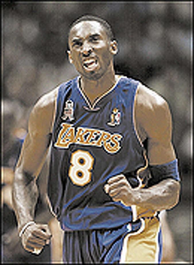 Los Angeles Lakers' Kobe Bryant reacts during the second half of Game 4 of the NBA Finals against the New Jersey Nets in East Rutherford, N.J. Wednesday June 12, 2002. (AP Photo/Rusty Kennedy) Photo: AP / AP