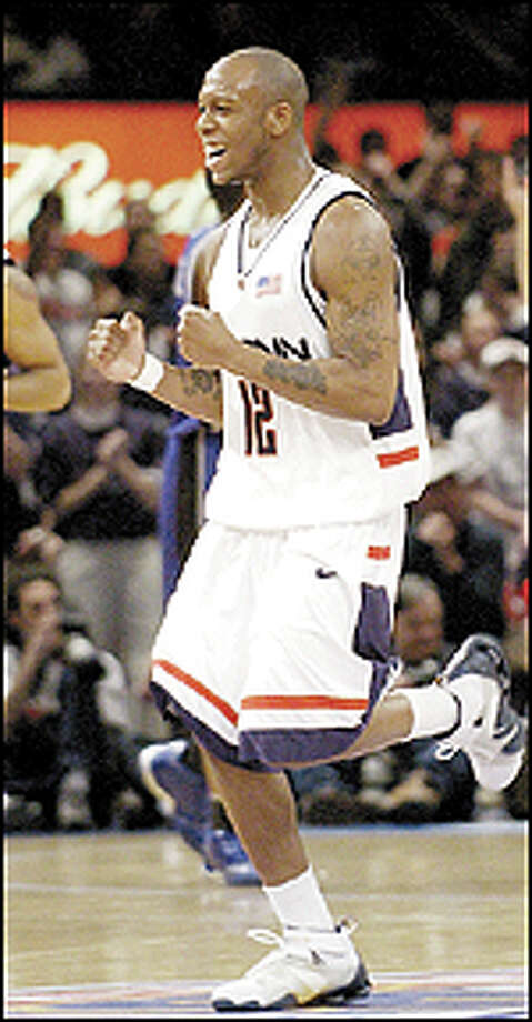 Taliek Brown of Connecticut reacts in the second half against Seton Hall in a quarterfinal of the Big East Championships Thursday, March 13, 2003 in New York. UConn won 83-70. (AP Photo/Frank Franklin ll) Photo: AP / AP