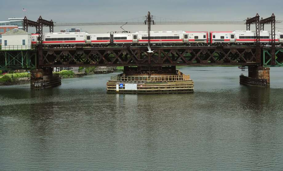 The Metro-North railroad span over the Norwalk River Thursday, July 27, 2017, in Norwalk Conn. The Norwalk Harbor Management Commission is looking to participate in regional feasibility study of 'non-traditional dredging alternative and use of suitable dredge spoils for coastal erosion control and barrier island nourishment.' That would entail 'suction dredging' of silted areas as needed or as part of regular maintenance. The Western Connecticut Council of Governments is sponsoring the study in conjunction with a nonprofit organization. Photo: Erik Trautmann / Hearst Connecticut Media / Norwalk Hour