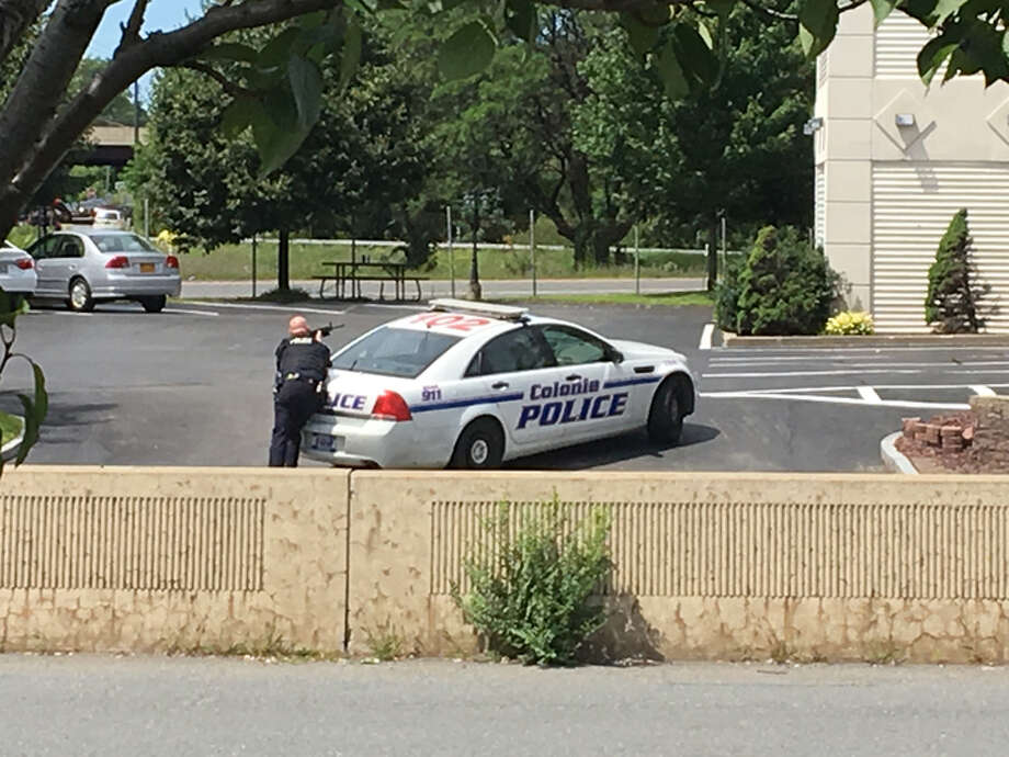Police respond to a call at the Cocca's Inn and Suites in Colonie Saturday.