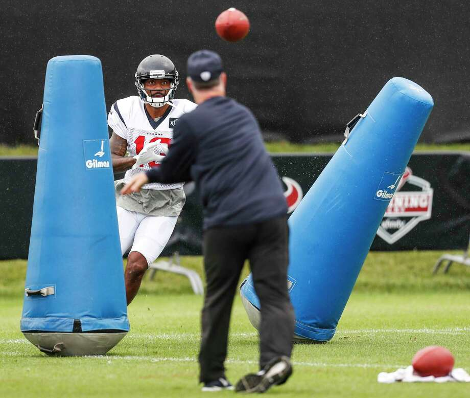 Houston Texans wide receiver Braxton Miller (13) waits for a throw from wide receivers coach John Perry during training camp at the Greenbrier on Saturday, July 29, 2017, in White Sulphur Springs, W.Va. Photo: Brett Coomer, Houston Chronicle / © 2017 Houston Chronicle}