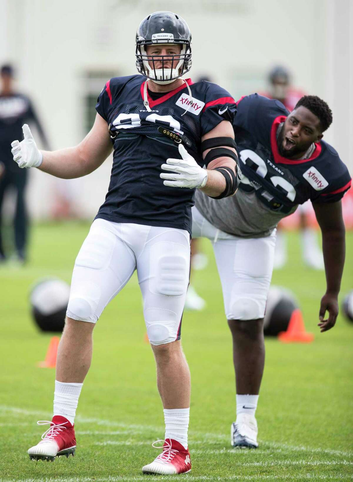Houston Texans defensive end J.J. Watt (99) and Houston Texans defensive tackle Brandon Dunn (92) celebrate a call while playing 4-square before practice during training camp at the Greenbrier on Saturday, July 29, 2017, in White Sulphur Springs, W.Va.