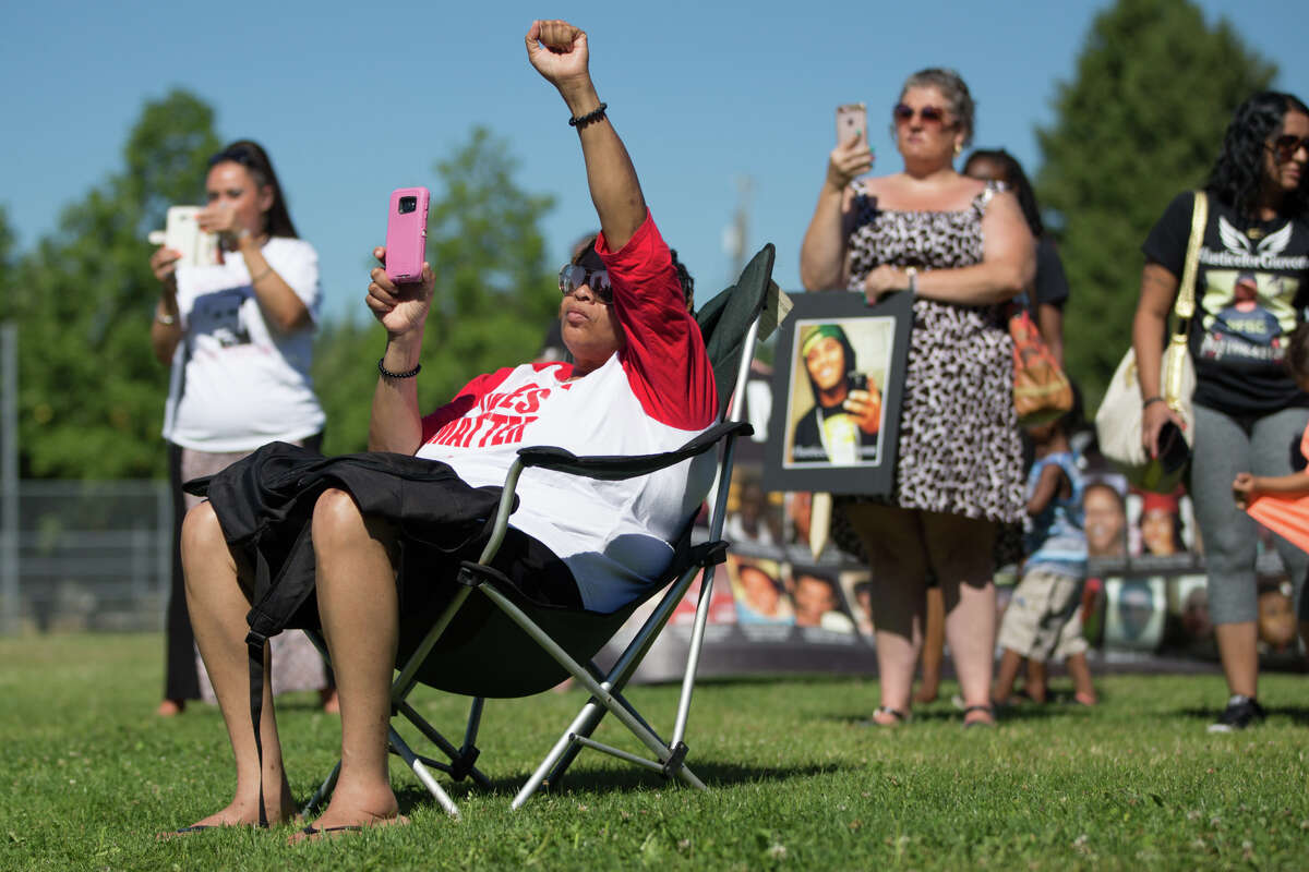 The crowd reacts to a poem about institutional racism and police violence during a rally for Charleena Lyles and her family at Judkins Park on Saturday, July 29, 2017.