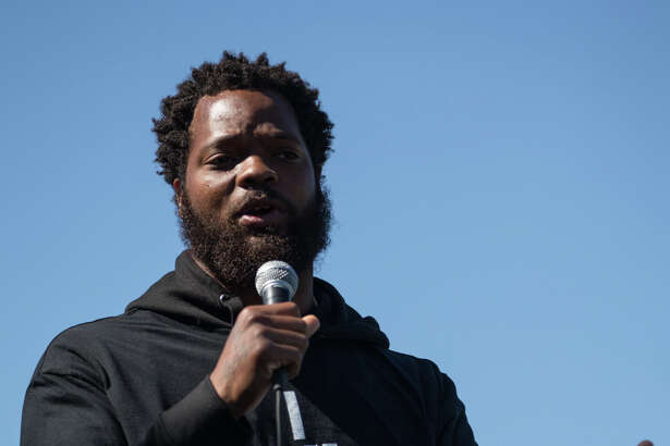 Seahawks' Michael Bennett speaks during a rally he hosted for Charleena Lyles and her family at Judkins Park on Saturday, July 29, 2017.