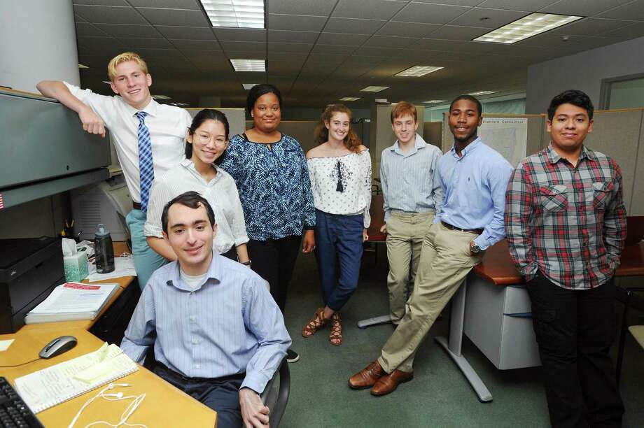 The Mayor's Youth Employment Program interns working inside the city's Office of Economic Development, from left, Noah Swan, 18; Dong Zhu Guo, 18; Matthew Fried, 21; Gabryail Meeks, 18; Abby Bushell, 18; Ben Adams, 17; Toussaint Williams, 21; Marcos Martinez, 16. Photographed inside Government Center in downtown Stamford on July 24. Photo: Michael Cummo / Hearst Connecticut Media / Stamford Advocate