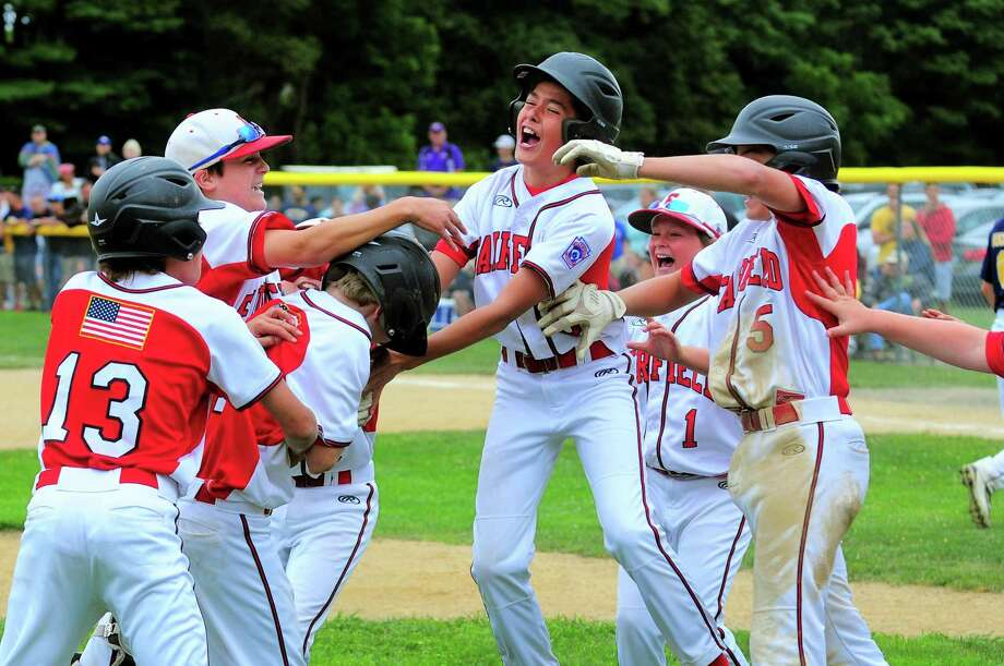 Fairfield American celebrates its win over Newington during Little League state tournament action in Guilford, Conn. on Saturday July 29, 2017. Photo: Christian Abraham / Hearst Connecticut Media / Connecticut Post