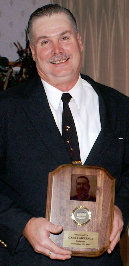 Gary Lawrence with his Connecticut ASA Hall of Fame plaque in 2007. Photo: Contributed Photo / Greenwich Time Contributed