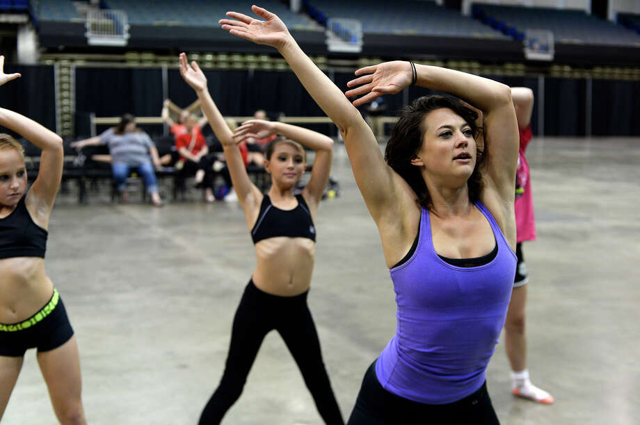"""Lauren Froderman leads a dance class during the National Day of Dance celebration at the Beaumont Civic Center on Saturday. Froderman won season seven of the dance competition show """"So You Think You Can Dance.""""  Photo taken Saturday 7/29/17 Ryan Pelham/The Enterprise Photo: Ryan Pelham / ©2017 The Beaumont Enterprise/Ryan Pelham"""