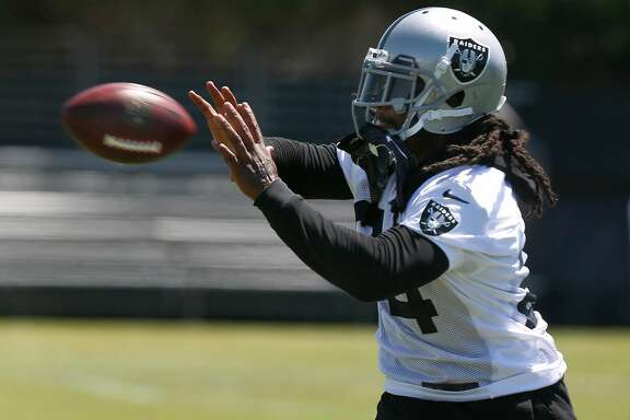 Running back Marshawn Lynch participates in a passing drill during the first day of practice at the Oakland Raiders training camp in Napa, Calif. on Saturday, July 29, 2017.