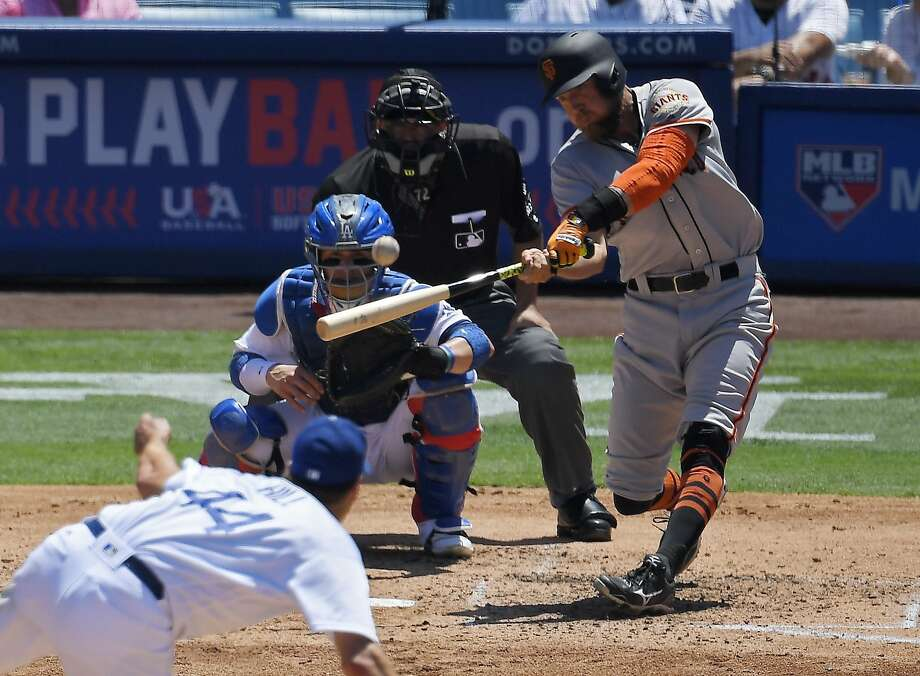 Hunter Pence homers off Rich Hill in the fourth inning. Photo: Mark J. Terrill, Associated Press