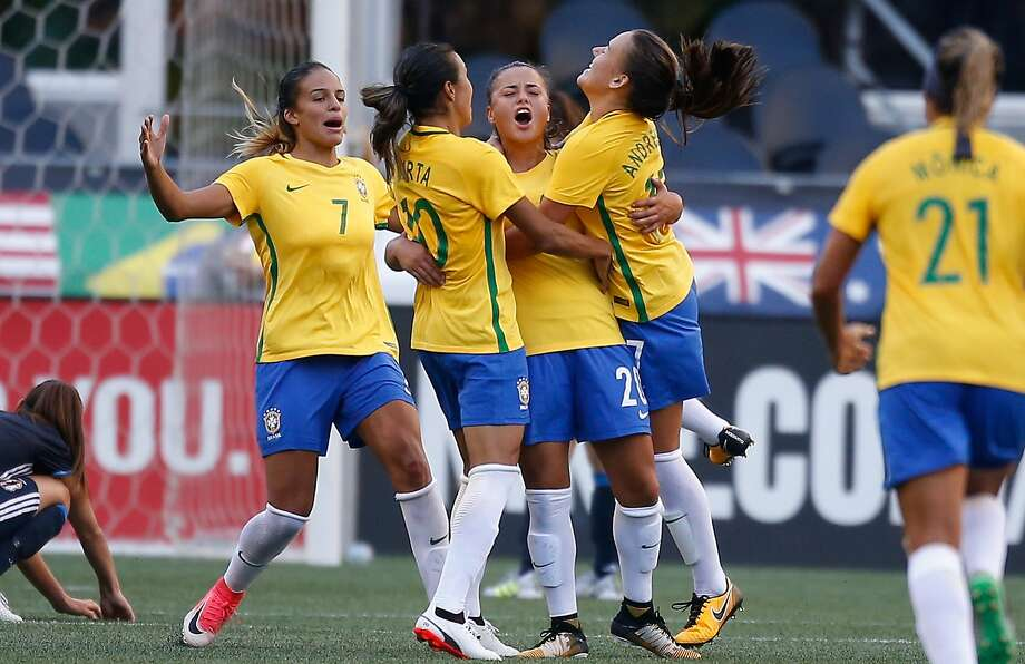 Camila (center) is hugged by Marta (10) after scoring against Japan on Thursday during the Tourna- ment of Nations in Seattle. Photo: Otto Greule Jr, Getty Images