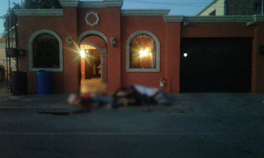 Headline: 'This is not a game, nephew': Pile of bodies discovered outside Nuevo Laredo residence Photo: Courtesy