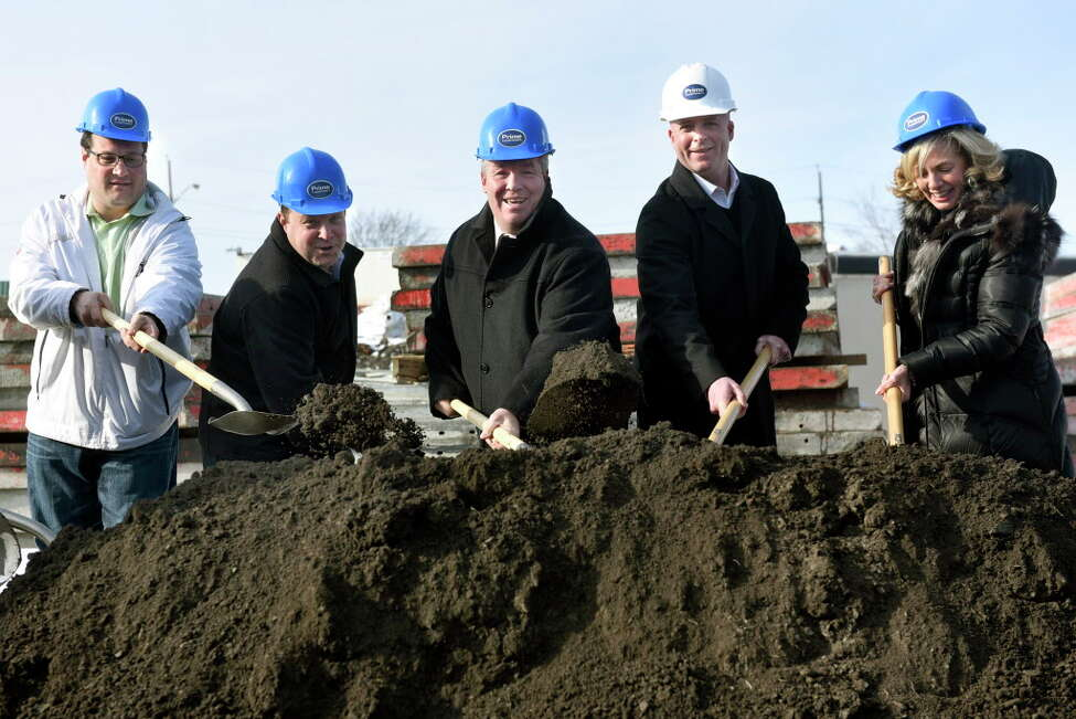 Ralph Signoracci, left, and Cohoes Mayor Shawn Morse, center, are among those breaking ground for the Hudson Square luxury apartment complex on Tuesday, Dec. 13, 2016, in Cohoes, N.Y. Signoracci is a county legislator and chairman of Cohoes Industrial Development Agency. (Cindy Schultz / Times Union)